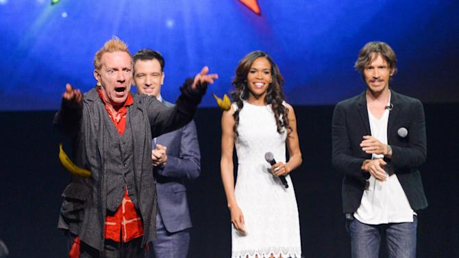 """FILE - In this April 4, 2014 file photo, from left, singer John Rotten Lydon throws bananas at the media, JC Chasez, Michelle Williams and Brandon Boyd look on, at the """"Jesus Christ Superstar"""" arena spectacular press conference and press performance to announce a North American arena tour in New York. The new arena version of """"Jesus Christ Superstar"""" has abruptly canceled its 54-city tour just days before its launch in New Orleans. Producers quietly pulled the plug on the project Friday without explanation. Fran Curtis, a publicist for the show from press representative Rogers & Cowan, did not return messages seeking a reason for the cancellation. The tour was to start June 9 at Lakefront Arena in New Orleans and include stops in Detroit, Los Angeles, Chicago, St. Louis, Phoenix, Seattle, Las Vegas, Denver, New York City, Boston and Philadelphia. (Photo by Evan Agostini/Invision/AP)"""