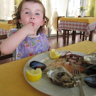 toddler eating seafood