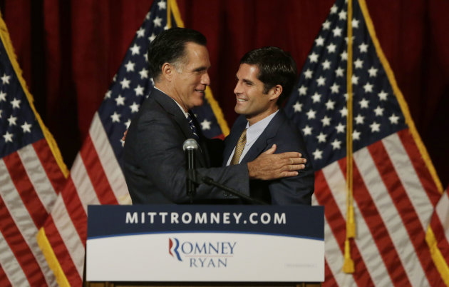 Republican presidential candidate and former Massachusetts Gov. Mitt Romney, left, is introduced by his son Matt before he speaks at a campaign fundraising event in Del Mar, Calif., Saturday, Sept. 22, 2012. (AP Photo/Charles Dharapak)