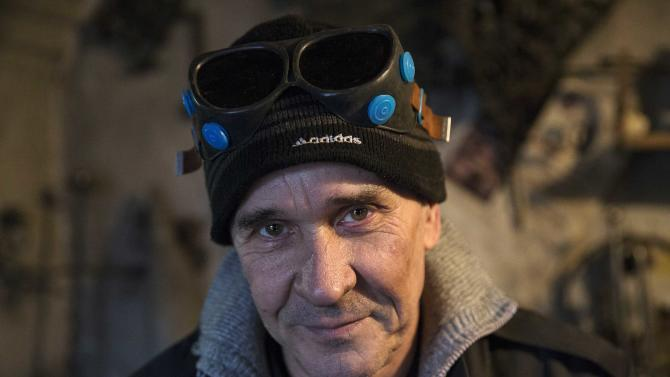 Local blacksmith Viktor Mikhalev is pictured at his shop in Donetsk