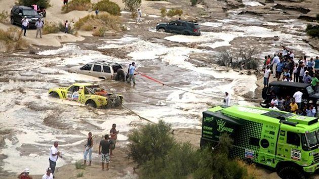 Cars and trucks are seen stuck after a flood on the Dakar Rally (Reuters)