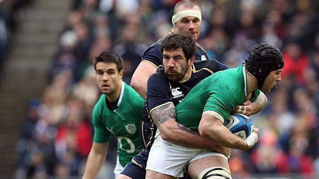 Sean O'Brien of Ireland (R) is tackled by Jim Hamilton of Scotland during the Six Nations international rugby union match between Scotland and Ireland at Murrayfield Stadium in Edinburgh on February 24, 2013 (AFP)