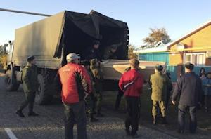 Russian servicemen unload a coffin containing the body…