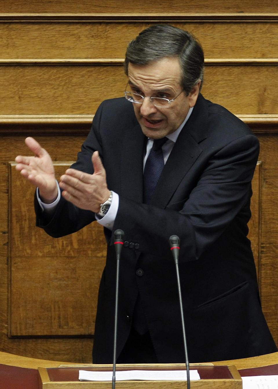Conservative opposition leader Antonis Samaras speaks during a parliament session in Athens, Thursday, Nov. 3, 2011. Samaras called on the prime minister to resign and led his party in a dramatic walkout during a parliamentary debate about the viability of the government. (AP Photo/Petros Giannakouris)