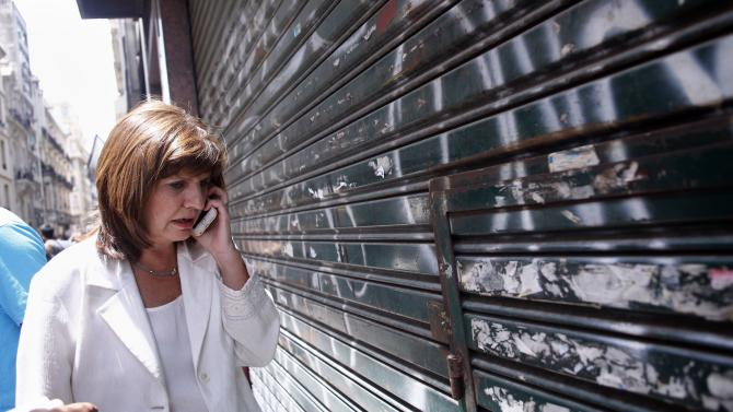 Argentine lawmaker Bullrich talks on the phone after leaving the office of prosecutor Viviana Fein, who is investigating the death of prosecutor Alberto Nisman, in Buenos Aires