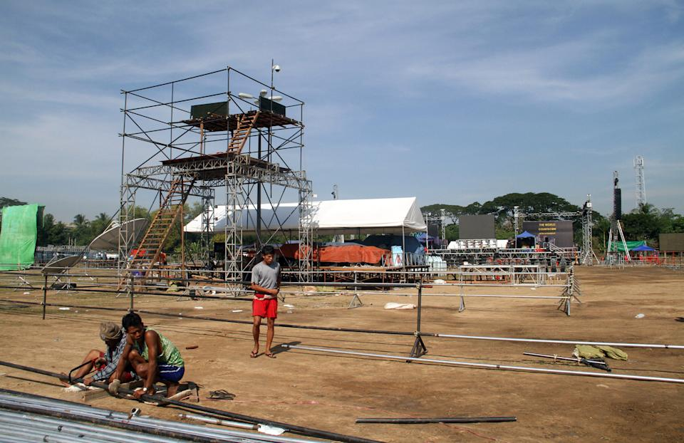 Workers prepare to set up a stage as preparations are underway for the country's first ever public New Year's countdown celebration, at Myoma grounds in Yangon, Myanmar, Monday, Dec. 31, 2012. (AP Photo/Khin Maung Win)