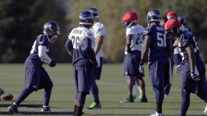 Seattle Seahawks fullback Michael Robinson (26) takes part in an NFL football practice, Tuesday, Oct. 22, 2013, in Renton, Wash. (AP Photo/Ted S. Warren)