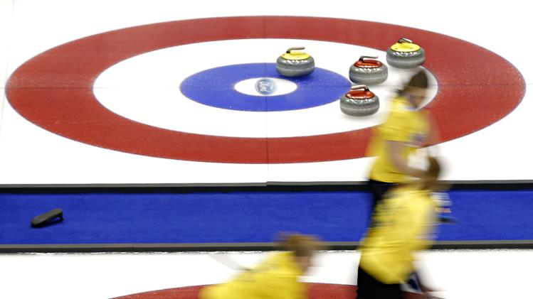 Sweden's skip Sigfridsson delivers a stone during her draw against the United States at the World Women's Curling Championships in St. John