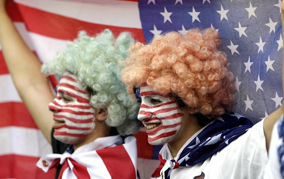 Fans of the United States wait for the start of women's gold medal match between the United States and Japan at the 2012 Summer Olympics, Thursday, Aug. 9, 2012, in London. (AP Photo/Ben Curtis)