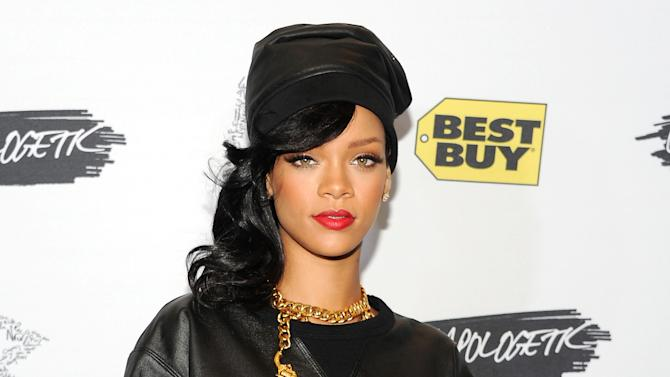 FILE - This Nov. 20, 2012 file photo shows singer Rihanna at a fan meet and greet at the Best Buy Theater in New York. Rihanna's collection for British brand River Island is slated for its debut next month during London Fashion Week. Fashion week organizers listed the pop star on its official calendar of fall previews as they sent out registration materials on Thursday to the editors, stylists and retailers who cover designer collections. The 24-year-old's first collection of clothing and accessories will be shown Feb. 16.  (Photo by Evan Agostini/Invision/AP, file)
