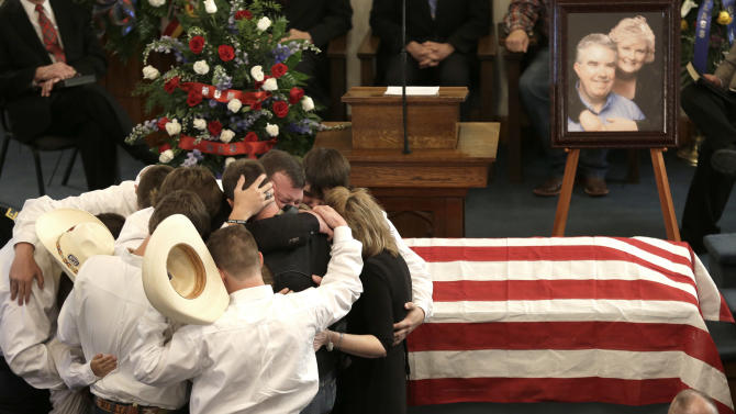 AP10ThingsToSee - The family of Kaufman County District Attorney Mike McLelland and his wife, Cynthia, comfort each other during their funeral services at the First Baptist Church of Wortham in Wortham, Texas on Friday, April 5, 2013. The couple was found shot to death Saturday in their house near Forney, about 20 miles east of Dallas. No arrests have been made. (AP Photo/LM Otero, File)