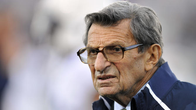 FILE - In this Oct. 22, 2011 file photo, Penn State coach Joe Paterno stands on the field before his team's NCAA college football game against Northwestern, in Evanston, Ill. A new era is dawning at Penn State, with a new football coach and a new look to the uniforms.  But no Paterno on the sideline in a season opener for the first time since 1965. Penn State plays Ohio on Saturday. (AP Photo/Jim Prisching, File)