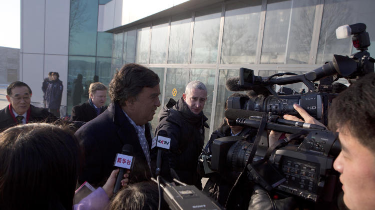 Former Governor of New Mexico Bill Richardson is surrounded by journalists as he walks into the Pyongyang International Airport in Pyongyang, North Korea as he and Google Chief Executive Eric Schmidt, not seen, depart for Beijing on Thursday, Jan. 10, 2013. (AP Photo/David Guttenfelder)