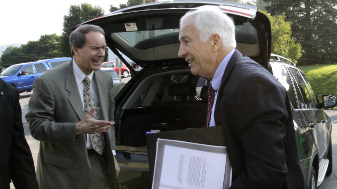 Former Penn State University assistant football coach Jerry Sandusky, right, arrives with his attorney Joe Amendola at the Centre County Courthouse in Bellefonte, Pa., Wednesday, June 20, 2012. Sandusky is charged with 51 counts of child sexual abuse involving 10 boys over a period of 15 years.  (AP Photo/Gene J. Puskar)