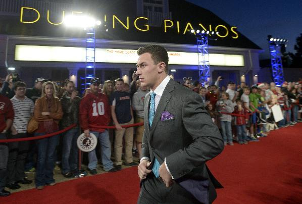 Texas A&M quarterback Johnny Manziel arrives on the red carpet for the College Football Awards show in Lake Buena Vista, Fla., Thursday, Dec. 12, 2013