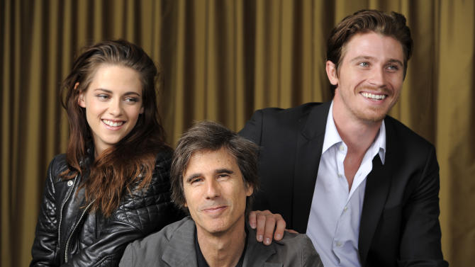 """Walter Salles, center, director of the film """"On the Road,"""" poses with cast members Kristen Stewart, left, and Garrett Hedlund at the 2012 Toronto Film Festival, Saturday, Sept. 8, 2012, in Toronto. (Photo by Chris Pizzello/Invision/AP)"""