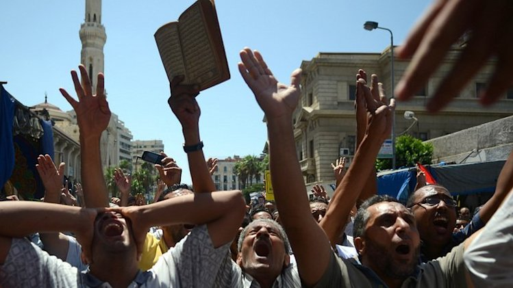 Supporters of the Muslim Brotherhood protest in the Egyptian coastal city of Alexandria on August 30, 2013