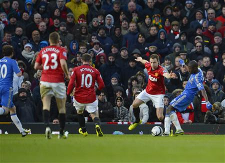 Chelsea's Ramires shoots to score against Manchester United during their English FA Cup quarterfinal match in Manchester