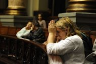 A woman prays as she attends the debate by the Uruguayan Senate on the law legalizing abortion. Uruguay became only the second country in mostly Catholic South America to legalize abortion