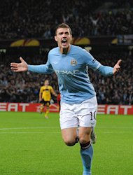 Edin Dzeko has insisted he is happy at Manchester City
