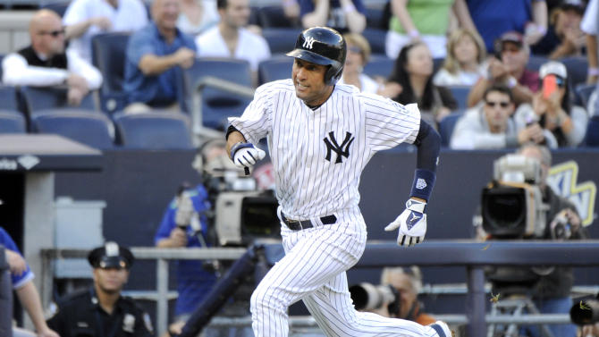 New York Yankees' Derek Jeter scores on a single by Brian McCann during the third inning of a baseball game Against the Toronto Blue Jays Saturday, Sept. 20, 2014, at Yankee Stadium in New York. (AP Photo/Bill Kostroun)