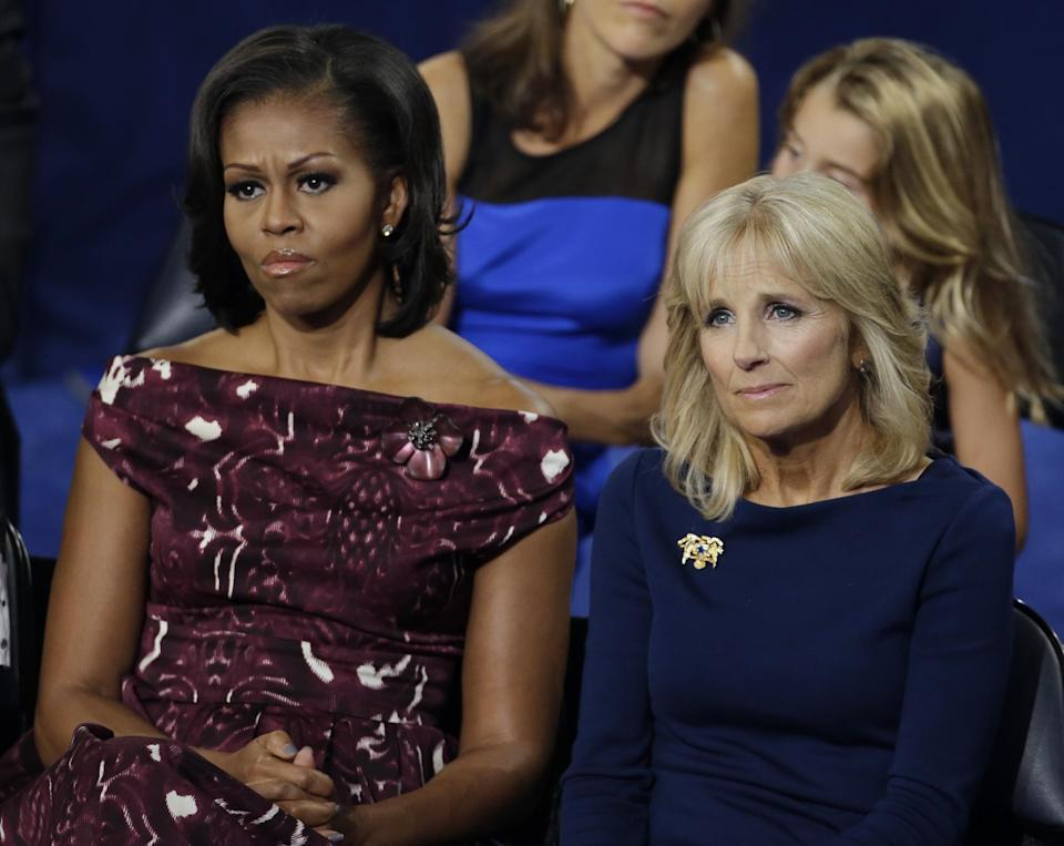 First lady Michelle Obama, left and Dr. Jill Biden, wife of Vice President Biden, listen to Vice President Joe Biden at the Democratic National Convention in Charlotte, N.C., on Thursday, Sept. 6, 2012. (AP Photo/Charlie Neibergall)