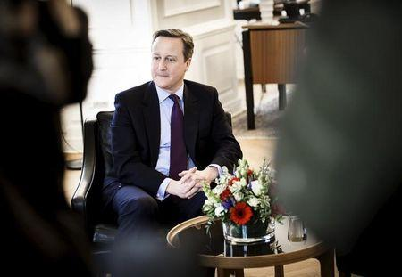 Danish Prime Minister Lokke Rasmussen (unseen) meets with his British counterpart Cameron at the Prime Minister's Office in Copenhagen