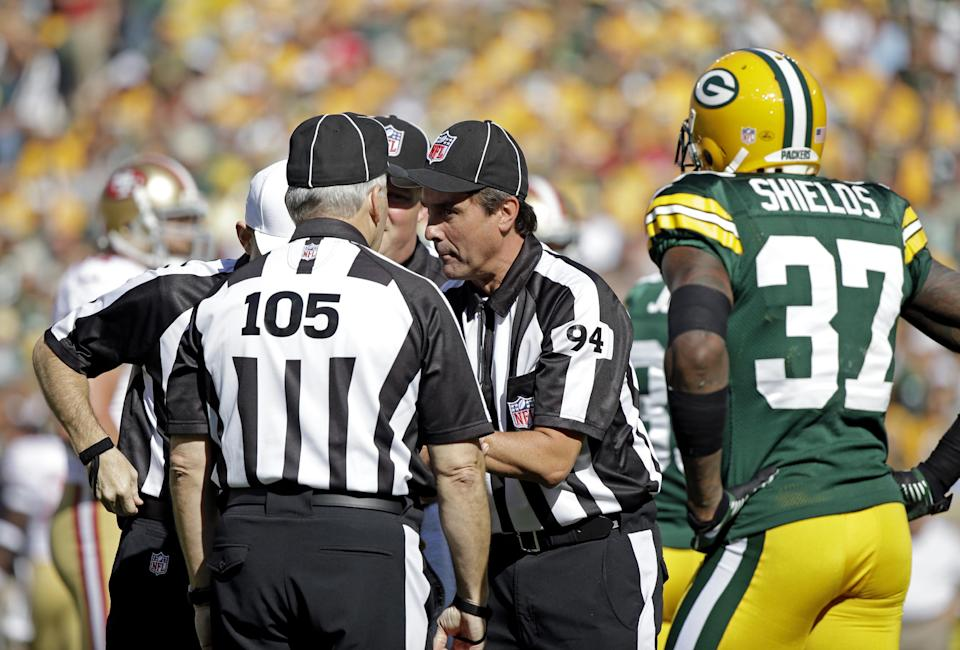 Green Bay Packers' Sam Shields (37) watches as referees talk about a play during the first half of an NFL football game against the San Francisco 49ers Sunday, Sept. 9, 2012, in Green Bay, Wis. (AP Photo/Morry Gash)