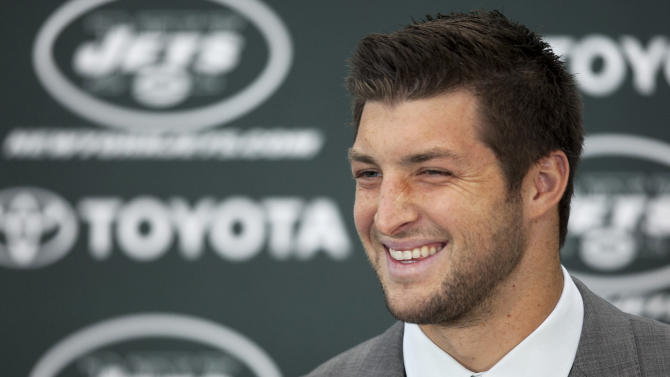 FILE - Tim Tebow holds his first news conference with the New York Jets, in this March 26, 2012 file photo taken in Florham Park, N.J. Manny Pacquiao welcomed a high-profile visitor to his training camp Saturday March 21, 2015 with ties to his native Philippines: Tim Tebow. (AP Photo/Mark Lennihan, File)