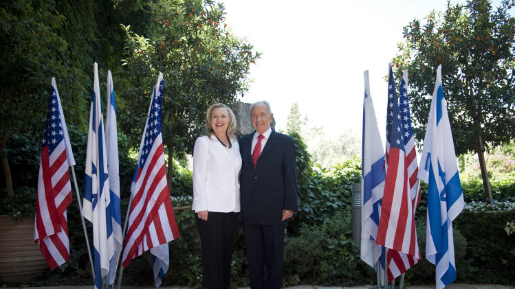 Israel's President Shimon Peres, right, and U.S. Secretary of State Hillary Rodham Clinton, left, pose for a photo before their meeting at the President's residence in Jerusalem, Monday, July 16, 2012. Although Clinton's agenda is designed to cover the breadth of U.S.-Israeli relations, the lack of action on peace talks between Israel and the Palestinians will be in the spotlight. (AP Photo/ Brendan Smialowski, Pool)
