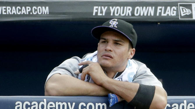 Colorado Rockies' Nolan Arenado stands in the dugout with a splint on his finger during a baseball game against the Atlanta Braves, Saturday, May 24, 2014, in Atlanta. The Rockies placed Arenado on the 15-day disabled list Saturday, one day after he broke his left middle finger on a head-first slide into second base. (AP Photo/David Goldman)