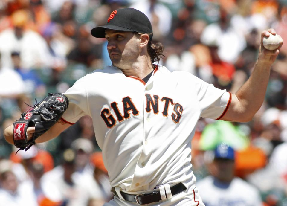 San Francisco Giants pitcher Barry Zito throws to the Los Angeles Dodgers during the first inning of a baseball game in San Francisco, Saturday, July 28, 2012. (AP Photo/George Nikitin)