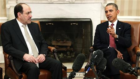U.S. President Barack Obama (R) and Iraq's Prime Minister Nuri al-Maliki (L) talk to reporters in the Oval Office after meeting at the White House in Washington, November 1, 2013. REUTERS/Jonathan Ernst