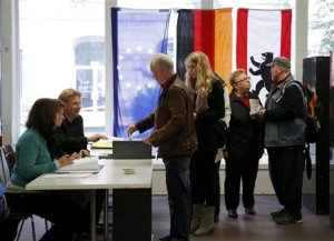 People queue as they prepare to vote during the German…