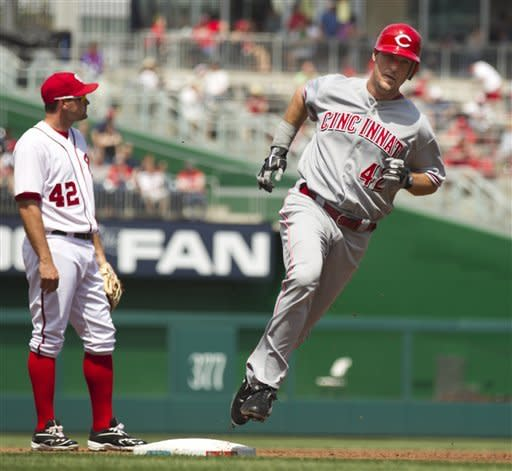 Votto has big hit in 11th, leads Reds over Nats