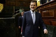 Spain's Prime Minister Mariano Rajoy arrives for a parliament session in Madrid. Rajoy announced Wednesday a 65-billion-euro austerity package to avert financial collapse as protesters against mining cuts clashed with police
