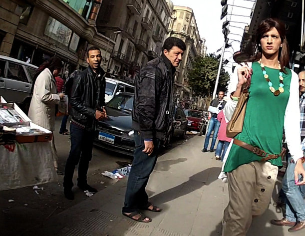 "In this undated image made from video released by the producers of ""Awel el Kheit,"" or ""the Thread,"" which aired in May 2013 on the private TV station ONTV, Waleed Hammad walks in a busy shopping district in Cairo, Egypt, dressed as a woman, as a hidden camera crew films him for an investigative story on sexual harassment. The 24-year-old actor dressed conservatively for his mission into the secret world of sexual harassment and abuse on the streets of Cairo, donning a long skirt and sleeved shirt and covering his head like many Egyptian women. (AP Photo/Courtesy of Awel el Kheit)"
