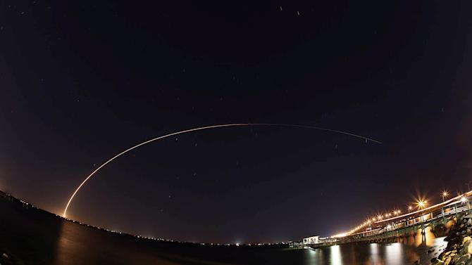 A 19-story Atlas 5 rocket built by United Launch Alliance streaks across the sky after lifting off from Cape Canaveral, Florida