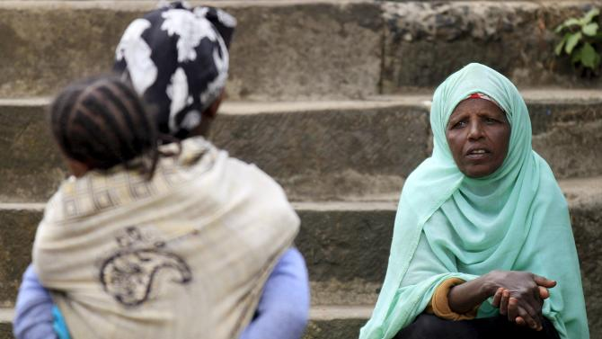 Women wait to vote at a polling station, as Ethiopia's national election kicks off in capital Addis Ababa