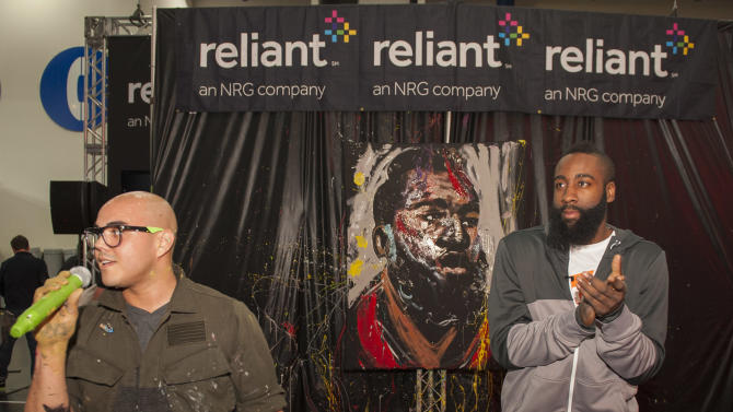 IMAGE DISTRIBUTED FOR RELIANT - Artist David Garibaldi, left, and Houston Rockets guard James Harden talk after Garibaldi painted a portrait of Harden during the NBA All-Star Jam Session sponsored by Reliant, Saturday, Feb. 16, 2013, in Houston. (Dave Einsel/AP Images for Reliant)
