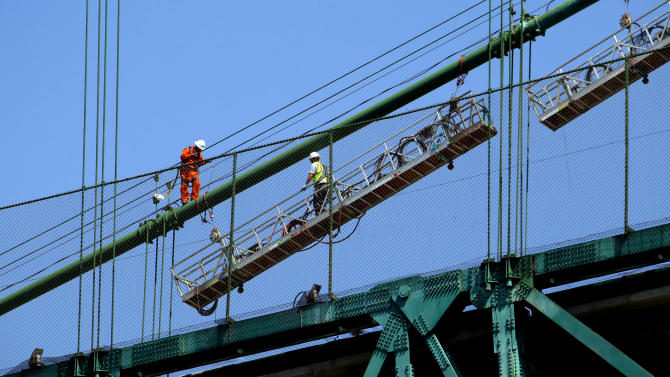 "Construction workers set up a scaffold  atop the Vincent Thomas Bridge in the San Pedro section of Los Angeles on Monday Aug. 20,2012. Tony Scott, director of such Hollywood hits as ""Top Gun,"" ''Days of Thunder"" and ""Beverly Hills Cop II,"" died Sunday Aug. 19, 2012, after jumping from the Los Angeles County bridge, authorities said.  (AP Photo/Nick Ut)"