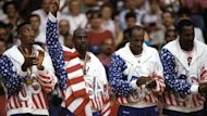 Scottie Pippen, Michael Jordan, Clyde Drexler and Karl Malone collect their golde medals at the 1992 Olympics