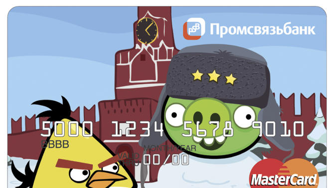 A credit card issued by Russia's Promsvyazbank shows Angry Birds characters, in Moscow, Tuesday, May 29, 2012. Russia's Promsvyazbank has become the first lender to offer their clients credit cards branded with Angry Birds characters. The sign in the top says Promsvyazbank. (AP Photo/Promsvyazbank, HOEP)