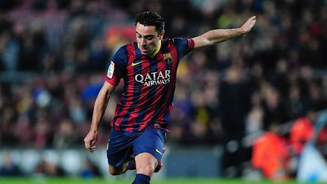 Barcelona's midfielder Xavi Hernandez scores during a match at the Camp Nou stadium in Barcelona on March 2, 2014