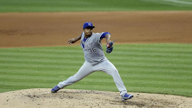 Kansas City Royals starting pitcher Edinson Volquez delivers in the fourth inning of a baseball game against the Cleveland Indians, Monday, July 27, 2015, in Cleveland. Volquez pitched six innings and gave up six hits and three runs. (AP Photo/Tony Dejak)