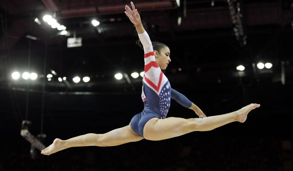 U.S. gymnast Alexandra Raisman performs on the balance beam during the artistic gymnastics women's apparatus finals at the 2012 Summer Olympics, Tuesday, Aug. 7, 2012, in London. (AP Photo/Gregory Bull)