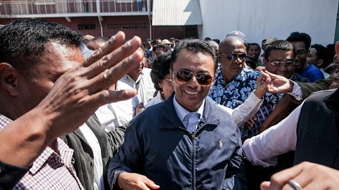 Marc Ravalomanana (centre), former president of Madagascar who was in exile in South Africa since 2009, is greeted by supporters while returning to his home in Antananarivo on October 13, 2014