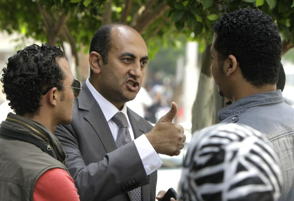 Presidential candidate, Khaled Ali gestures as he speaks to his supporters in Cairo, Egypt, Sunday, May 20, 2012. Egypt's youngest presidential candidate has joined dozens of activists on hunger strike to protest the continued detention of more than 300 people who face possible military prosecution. (AP Photo/Amr Nabil)
