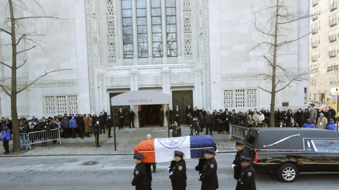 The casket containing the body of former New York City Mayor Ed Koch is carrfied by policemen  into Temple Emanu-El for his funeral in New York, Monday, Feb. 4, 2013.  Koch died Friday of congestive heart failure at age 88.  (AP Photo/Seth Wenig)
