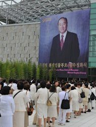 Unification Church devotees wait to mourn the death of founder Sun Myung Moon in Gapyeong. More than 150,000 mourners from South Korea and abroad, including 32,000 from Japan, are expected to pay their respects over the next 10 days